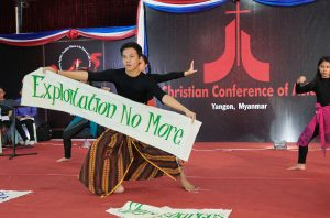Liturgical dancers from Indonesia lift banners highlighting themes of importance during the October 13, 2017, session of the Asia Mission Conference in Yangon, Myanmar.