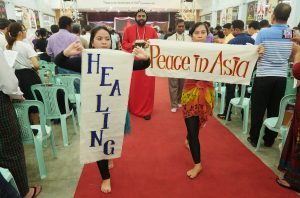 Liturgical dancers from Indonesia carry banners highlighting themes of importance during the October 13, 2017, session of the Asia Mission Conference in Yangon, Myanmar.