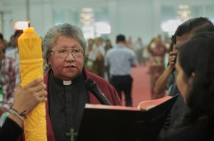 The Rev. Diana Tana, the vice moderator of the Christian Conference of Asia, reads the scriptures before preaching during the opening session of the Asia Mission Conference in Yangon, Myanmar, on October 12, 2017.