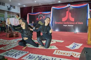 Liturgical dancers from Indonesia lead morning worship at the Asia Mission Conference in Yangon, Myanmar, on October 13, 2017.  Behind them, Emma Cantor, a regional missionary for United Methodist Women, reads the scriptures.